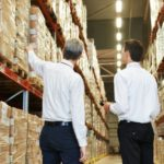 37749960 - two managers workers in warehouse with bar code scanner